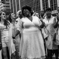 Revival Resistance Chorus sings with Take Back the Night - Rain or Shine!